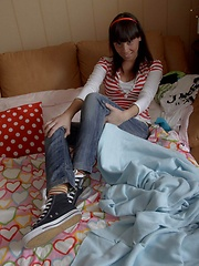 Hot teen takes off her jeans and masturbates