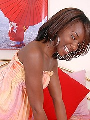 Beautiful black teen girl in her orange nightie dress teased-off and get naked