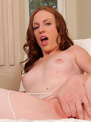 Sweet and young redhead slut wearing in white fishnet pantyhose