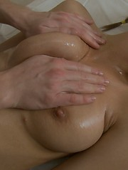 Smiling babe yields to a masseur
