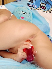 Horny chick stroking her wet clit with long dildo