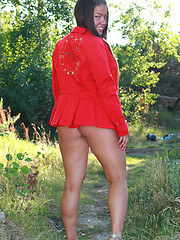 Chunky Asian shortie flashes her ass in the woods