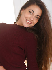 The gorgeous Lorena B confidently posing as she takes off her crimson sweater and lace panty