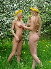 Gorgeous teen lesbians show juicy tits and neat pussies while posing naked in the garden.