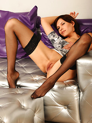Suzanna A bares her yummy tits and smooth pussy on the couch.