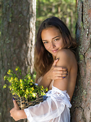 Top model Slava bares her gorgeous body as she strips in the woods.
