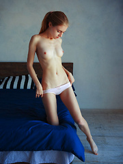 Youthful Shayla flaunts her petite, yummy body and sweet pussy on the bed.