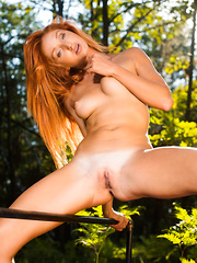 Alluring Michelle H shows off her lusty body in the woods.