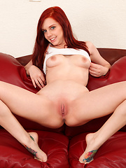Sexy Nubile Ginger Maxx takes off her clothes and plays with her amateur pussy on the couch
