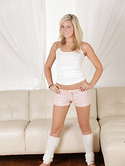 Hot blonde in leg warmers plays with her tickling rabbit toy deep in her fuck hole