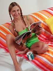 Blonde teen girl with pigtails solo posing