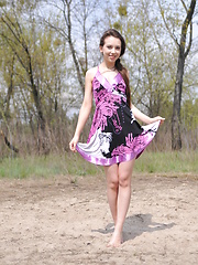 Adorable long haired teen cutie taking off clothes and showing her pretty body outdoors.