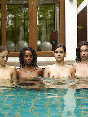 Sexy fashion models posing in the water