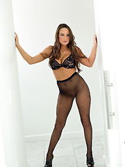 Busty Teal Conrad in fishnet pantyhose spreads her juicy pussy
