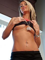 Nikki showing pink panties under her black shorts