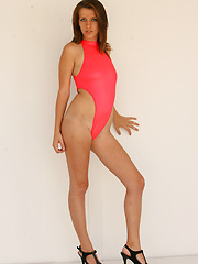 Wearing a bright colored one piece swimsuit Emily show whats under that suit