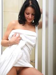Brunette teen hottie masturbates in a shower