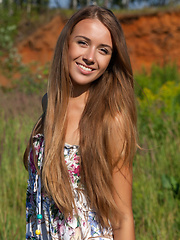 Even in the outdoors, wearing a casual flowery dress, Lina Diamond proves she has great potential to seduce anyone anywhere anytime, with her slim, slender body and enticing smile.