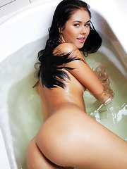 Macy indulges her hot, sexy body with a nice, relaxing bath as she tease and poses sensually all over the bathtub baring her delectable assets.