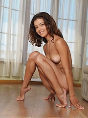 With her sultry gaze, awesome physique, great abs with gorgeous breasts and tight pussy, Divina is an enticing gift that needed not be unwrapped.