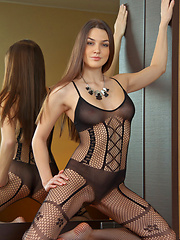 A double delight of Vanda\'s smoking hot body garbed in full body fishnet lingerie at first, then strips and reveals her delectable assests.