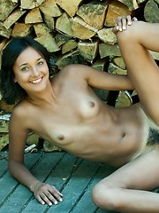 Chandra flashes her sweet, adorable smile as she flaunt her tanned, luscious body with enviable long legs, firm round rump and hairy snatch.