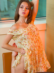 Nastya strikes a lot of sensually arousing poses in her beautiful flowery dress that shamelessly bares her delectable labia and irresistable breasts.