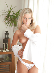 Miela flaunts her fresh, natural and trimmed labia and round, magnificent breasts with a warm, engaging smile.