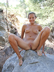 With her charming, youthful allure, tanned complexion, beautiful firm breasts with puffy nipples, Mango\'s natural beauty stands out on a rocky location.