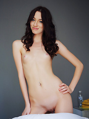Absolutely stunning and charming Zsanett Tormay with her sultry gaze, tempting looks, and pink, huge labia.
