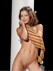 With just a scarf for an accessory, Divina delights her viewers with her warm, engaging smile and a full view of gorgeous, nubile body with medium puffy breasts, cute butt and irresistable labia.