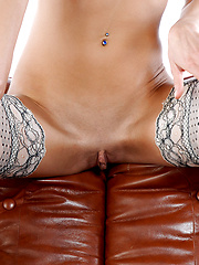 Athletic Rebecca is rubbing up on some soft leather and letting the friction get her wild.