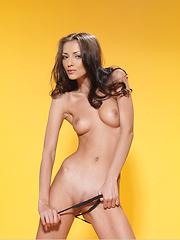 Slim babe shows her naked body