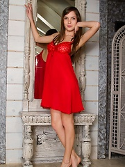 Semmi is a fine seductress clad in bright red night dress who's ready to fulfill your depest fantasies.