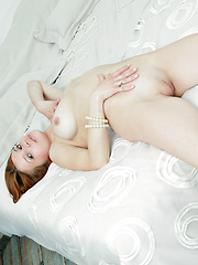 Elegant and charming red head gracing her debut series by the bed.