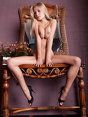 Candice B poses in a bedroom