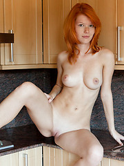 European redhead beauty shows her cherry on the kitchen