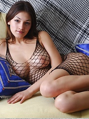 Hello Sofi, she is wearing a great fishnet dress that still shows her great hips ,large breasts and wonderful ass.
