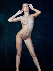 Kira with her delicious, moist pussy, perky and pink breasts, and tight, well-toned ass.