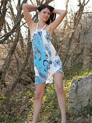 Brunette teen posing outdoors