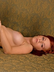 Ariel is a hot red head with a spankable bottom she dares you to smack as she runs naked all around you.