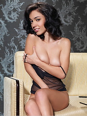 Wearing a black see through dress Helen flaunts her sexy body, smooth skin and gorgeous breasts on the sofa