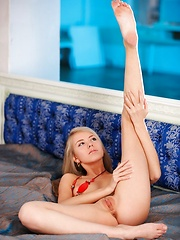 Naughty, sultry blonde brandishing her new accessory and her hot fleshy goods.