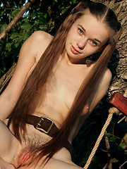Young fashion model exposes her cute unshaved hole