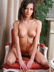 Irena is a brown haired beauty with small breasts, a toasty skin tone and big beautiful nipples.