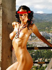 Gypsy Jenya exposes her round breasts and natural bush