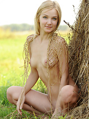 Naked blonde girl on the field