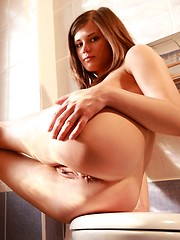 Caprice is simply beautiful with light brown hair and super perky nipples, she is in the bathroom.