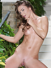 Oiled fashion model posing outdoor