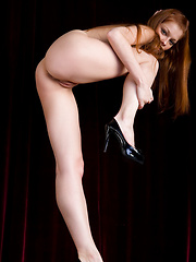 Exotic red haired girl who has milky white skin and cat like eyes looks like a sweet treat.